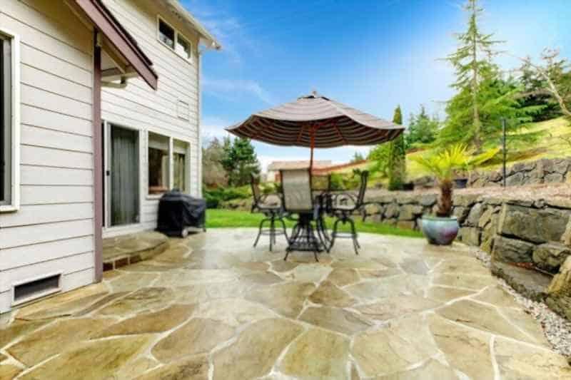 how to pour a concrete patio against a house
